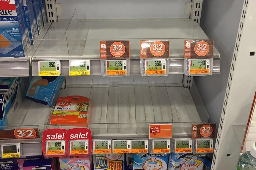 The shelves emptied of mosquito patches and repellents at the Guardian pharmacy at Novena Square.