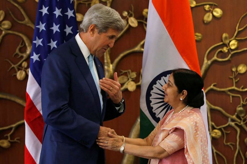 United States Secretary of State John Kerry with Indian Foreign Minister Sushma Swaraj before the start of the second India-US Strategic and Commercial Dialogue yesterday in New Delhi.