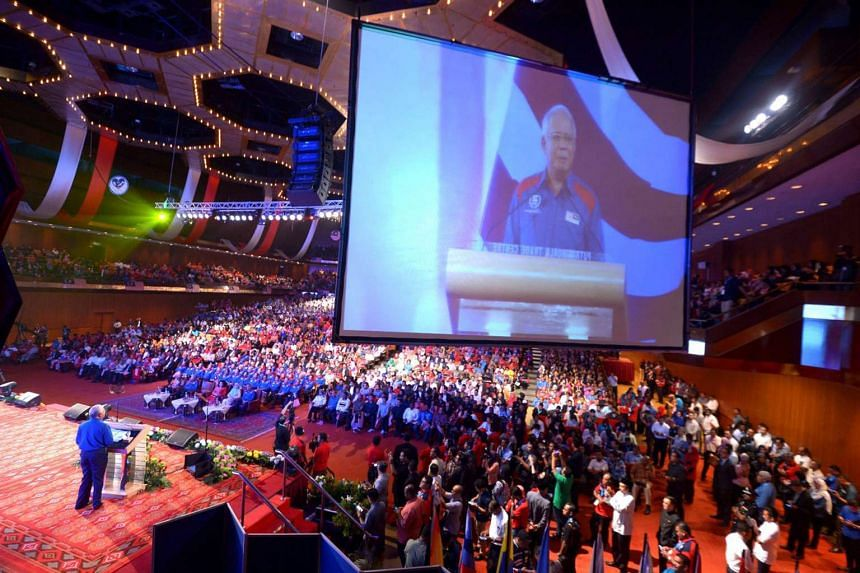 Mr Najib delivering his annual speech at Putra World Trade Centre in Kuala Lumpur last night, the eve of Malaysia's 59th Independence Day. He highlighted the country's economic achievements and infrastructure development.