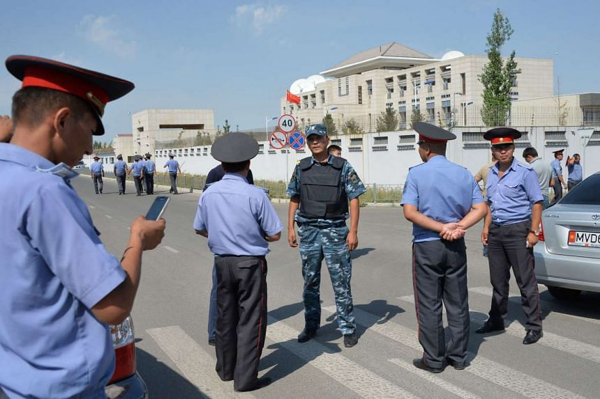 Kyrgyz police officers outside the Chinese embassy in Bishkek yesterday after a suicide bomber crashed his van through a gate of the compound. Kyrgyz law enforcement sources said the strength of the blast was equivalent to up to 10kg of TNT.