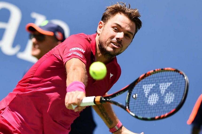 Stan Wawrinka of Switzerland hits a return against Fernando Verdasco of Spain.