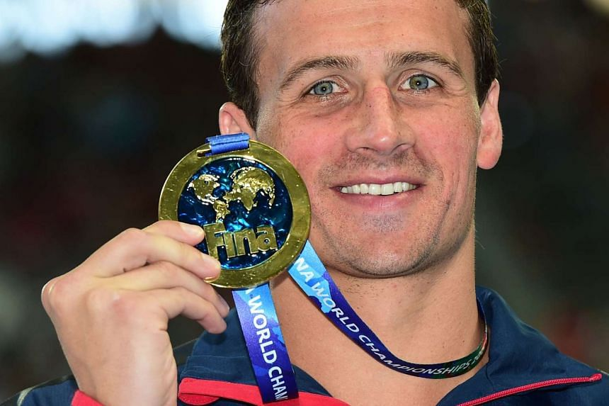 Ryan Lochte posing with his gold medal during the podium ceremony for the men's 200m individual medley swimming event at the 2015 FINA World Championships in Russia.