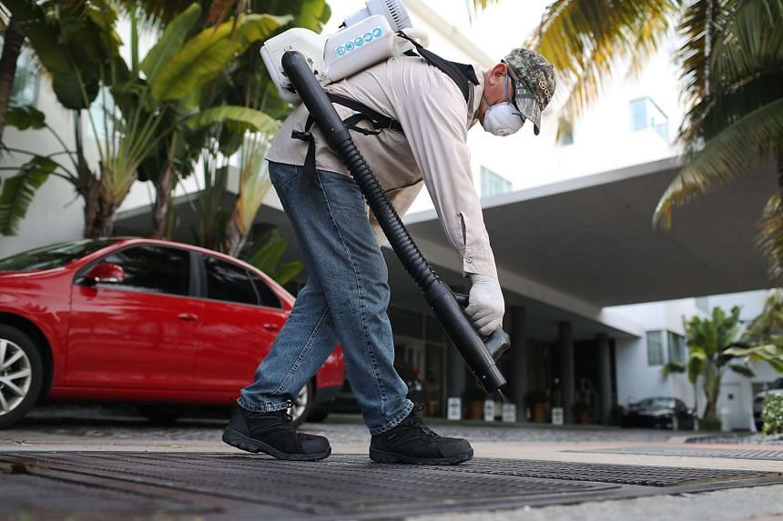 A mosquito control inspector prepares to spray a storm drain on Aug 24, 2016,  in Miami Beach, Florida, which has suffered a Zika outbreak.