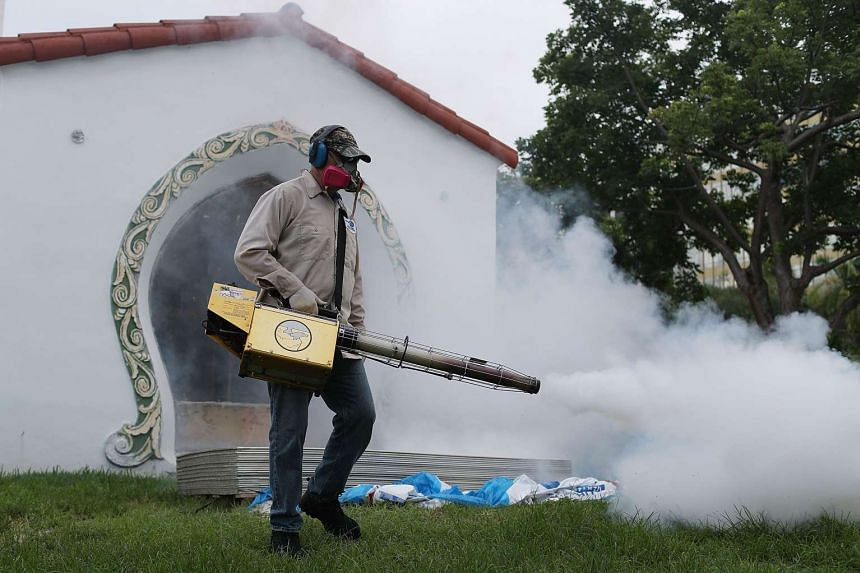 A Miami-Dade County mosquito control inspector uses a Golden Eagle blower to spray pesticide to kill mosquitoes in the Miami Beach neighborhood as the county fights to control the Zika virus outbreak, on Aug 24, 2016.