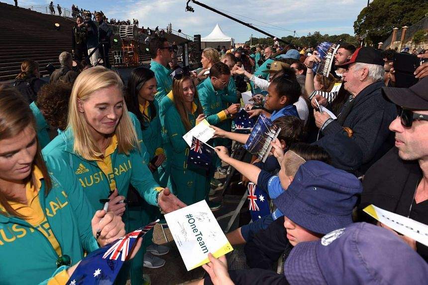 Australian Olympians (left) give autographs to fans during official welcome home celebrations at the Sydney Opera House on Aug 29, 2016.