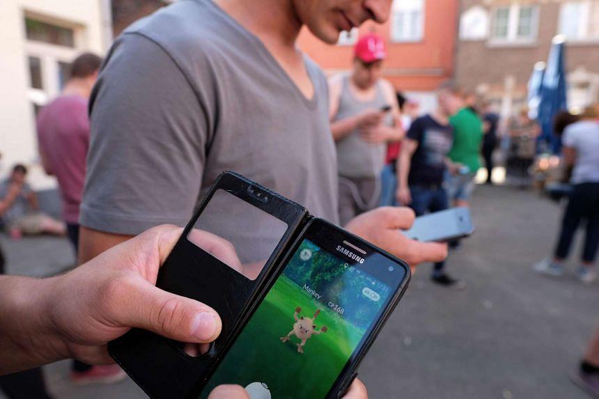 People play Pokemon GO in Lillo, Belgium on Aug 20, 2016.