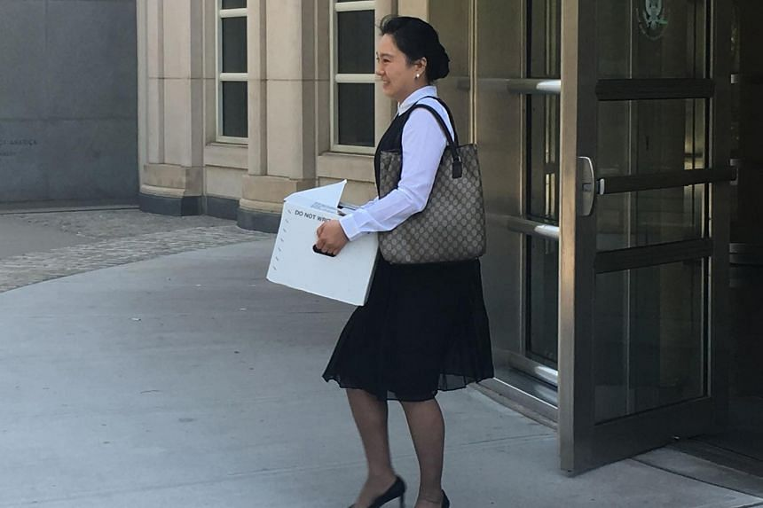Former Air China employee Ying Lin exits the building after a pre-trial hearing in a federal court in Brooklyn, New York on June 21, 2016.