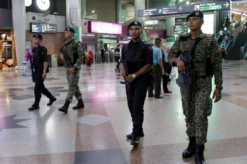 Police and army officers patroling at Kuala Lumpur Sentral railway station amid the tighter security measures following the grenade attack at a nightspot in Puchong which was linked to the Islamic State in Iraq and Syria (ISIS) group.