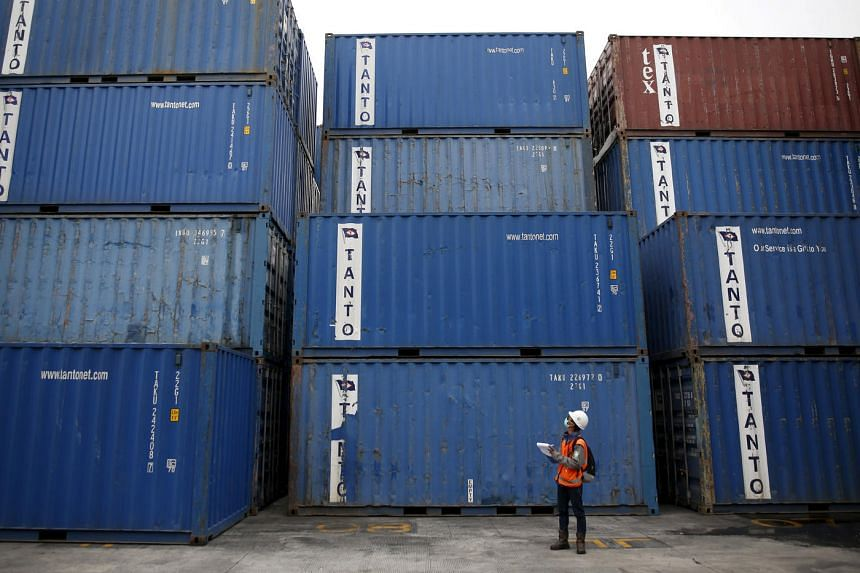 A worker tracks shipping containers in Tanjung Priok port in North Jakarta, Indonesia on Dec 15, 2015.