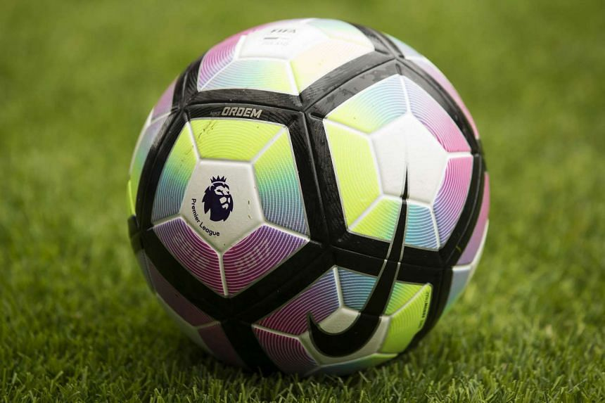 English Premier League logo is seen on the match ball ahead of the pre-season friendly football match between Wigan Athletic and Manchester United at the DW stadium in Wigan, northwest England, on July 16, 2016.