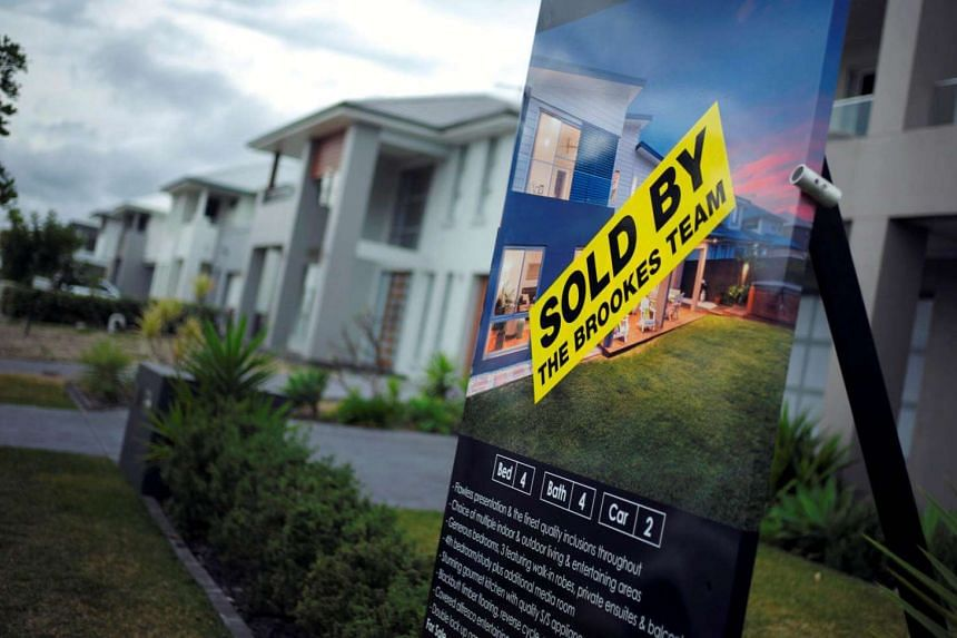 A newly-constructed home is listed as sold on an advertising board in the Sydney suburb of Greenhills Beach.