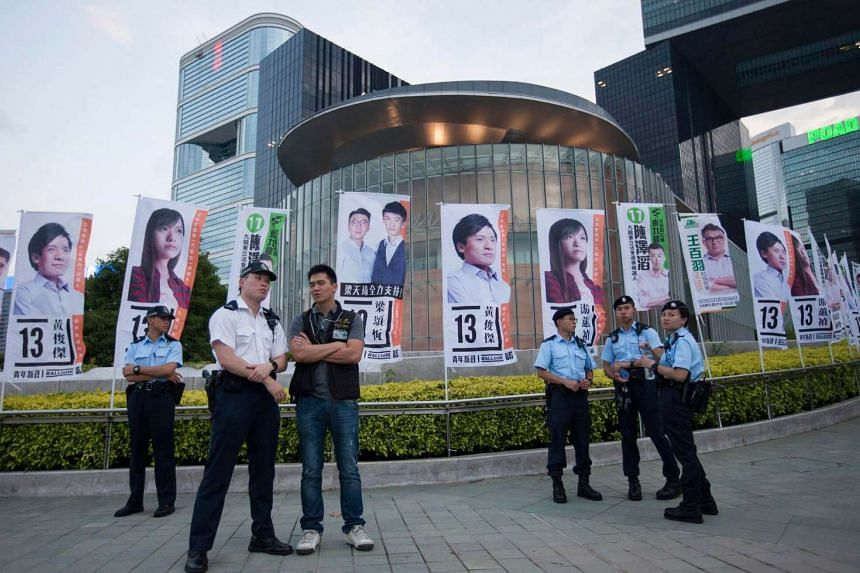 Police officers stand in front of the city's Legislative Council prior to an election rally by the Youngspiration political party, Hong Kong, on Aug 28.
