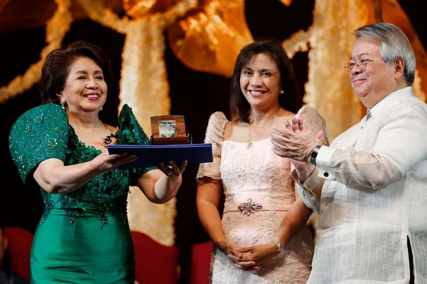 Ramon Magsaysay 2016 awardee, Conchita Carpio Morales (left) of the Philippines receives her prize from Philippine Vice President Leni Robredo (centre) during the award ceremony held in Manila, Philippines on Aug 31, 2016.