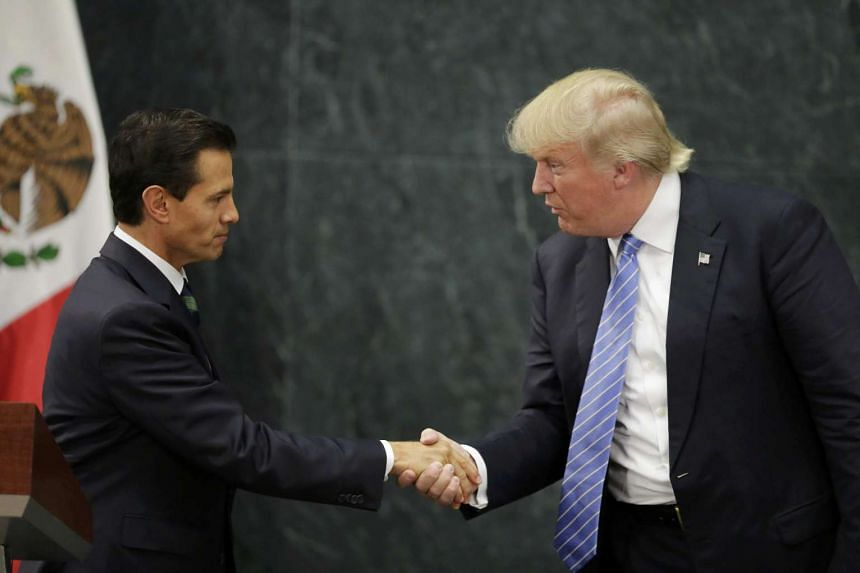 Mexico's President Pena Nieto (left) and US presidential nominee Trump shake hands in Mexico City on Aug 31.