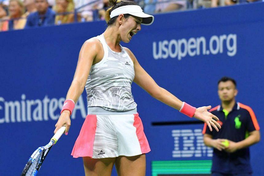 Garbine Muguruza of Spain after a miss against Anastasija Sevastova of Latvia on day 3 of the 2016 US Open tennis tournament.