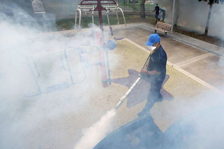 A worker fogs a community playground at a new Zika cluster area in Singapore on Sept 1, 2016.