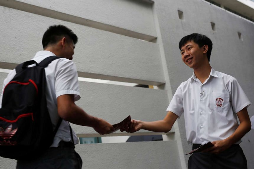 Student Parco Wong Lok-hang (right) hands out leaflets promoting Hong Kong independence in school at the first day of academic year on Sept 1, 2016.