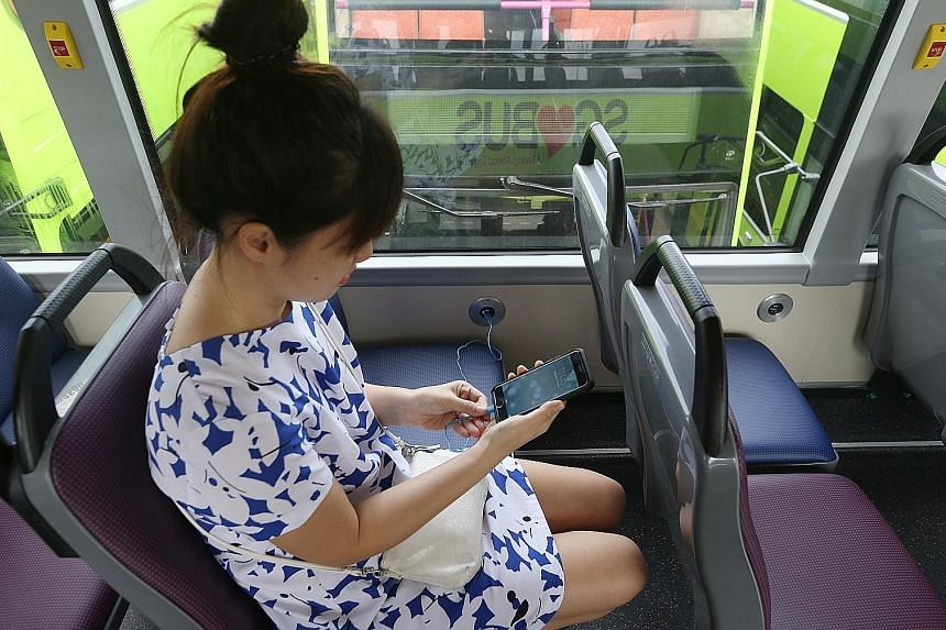 The 10 buses will begin running on five of SMRT's services from today. Commuters will have to use their own charging cables.