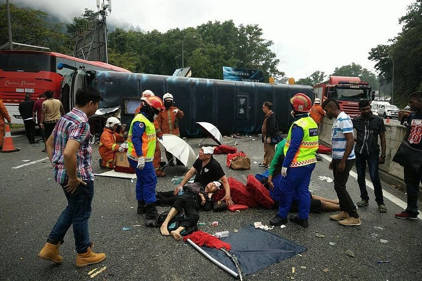 A leisure trip to the hilltop resort destination of Genting Highlands in Pahang turned into a nightmare for 12 Singaporeans when the tour bus taking them home yesterday flipped over on a highway linking Karak to Kuala Lumpur. Nine of the Singaporean