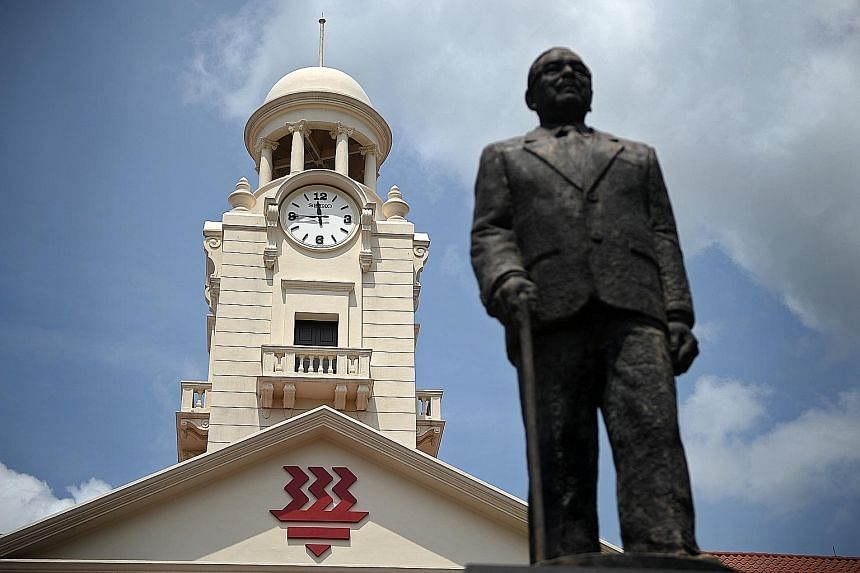 A statue of the school's founder, Tan Kah Kee, stands in front of the Hwa Chong clock tower. The classrooms in the Hwa Chong clock tower are now reserved for students in special programmes. Old boys (from left) Li Jiexun, 33, Ong Kim Tat, 73, Ang Gua