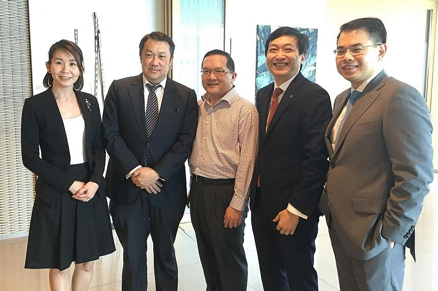 (From left) Ms Ng of Keppel Reit Management, Mr Ho of YTL Starhill Global Reit Management, Mr Tuck of Macquarie Securities Singapore, Mr Tay of Ascott Residence Trust Management and Mr Koh of Aims AMP Capital Industrial Reit spoke at a forum hosted b