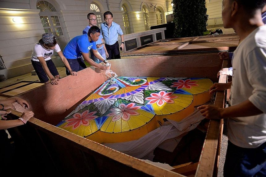 Preparations for a 4m-high lantern made out of fibreglass began at the Asian Civilisations Museum (ACM) yesterday. The lantern, called a parol, is traditionally made in the Philippines from bamboo sticks and covered with coloured pieces of paper. On