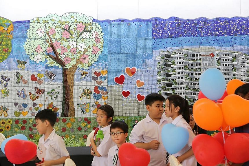 The 34.6m-long community mosaic art wall is the longest of its kind in Singapore. The wall is part of the first JurongHealth Arts&Health Festival, held yesterday to show how art can improve the welfare of patients and their families.