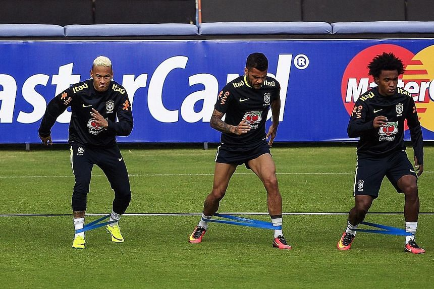 From left to right: Brazil footballers Neymar, Dani Alves and Willian training at Liga stadium in Quito, ahead of the Selecao's World Cup qualifier against Ecuador.
