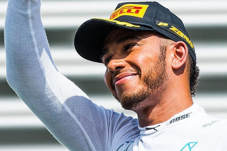 Lewis Hamilton on the podium after the Belgian Grand Prix on Sunday, when he finished third despite starting 21st on the grid. Nico Rosberg's pole-to-flag win cut Hamilton's title lead to 10 points.