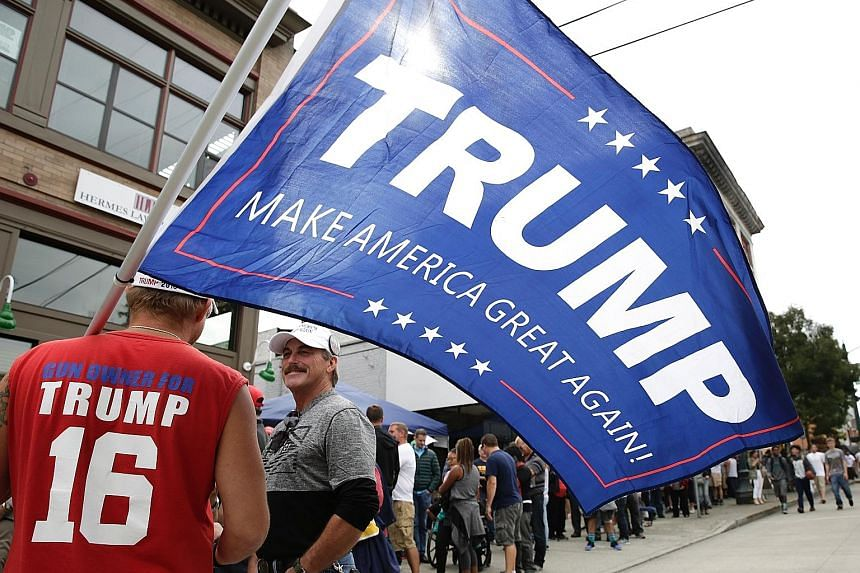 Mr Trump's supporters at a rally this week. He is caught between appeasing his staunchest supporters and trying to appeal to moderate Republicans and independent voters with a softer stance, particularly on deportations.