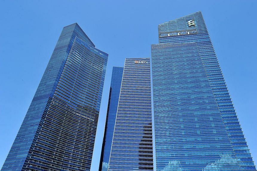 Marina Bay Financial Centre. Business loans fell 5 per cent year on year in July to reach $351.8 billion, the 11th straight month of decline, according to preliminary data released by the Monetary Authority of Singapore yesterday.