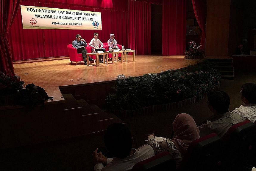 (From left) Dr Maliki, Dr Faishal and Ms Rahayu fielding questions from participants at the dialogue, which was held at the Grassroots Club in Yio Chu Kang yesterday.
