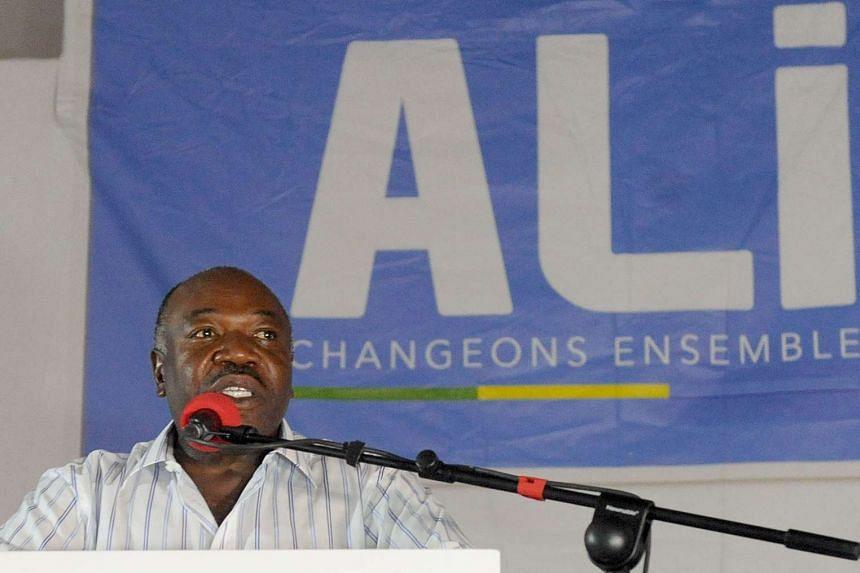 Gabon's incumbent president Ali Bongo Ondimba speaks to members of his campaign on Aug 28, 2016.