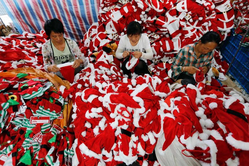 This photo taken on Aug 10, 2016 shows Chinese workers making Christmas items at a toy factory in Ganyu district in Lianyungang, east China's Jiangsu province.