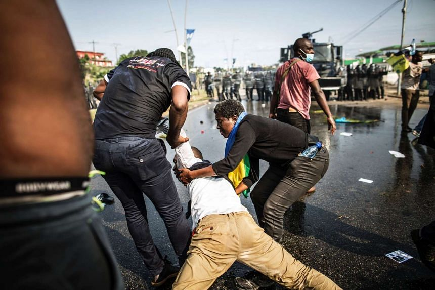 Supporters of Gabonese opposition leader Jean Ping clash with police on Aug 31, 2016, after Ali Bongo was declared the winner of a presidential election.