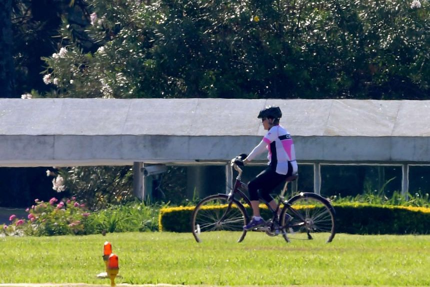 Dilma Rousseff rides her bicycle in Brasilia on Sept 1, 2016, a day after being stripped of her role as Brazil's president.