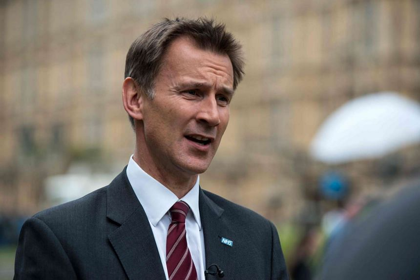 British Health Secretary Jeremy Hunt speaks to television broadcasters on College Green in London on June 30, 2016.