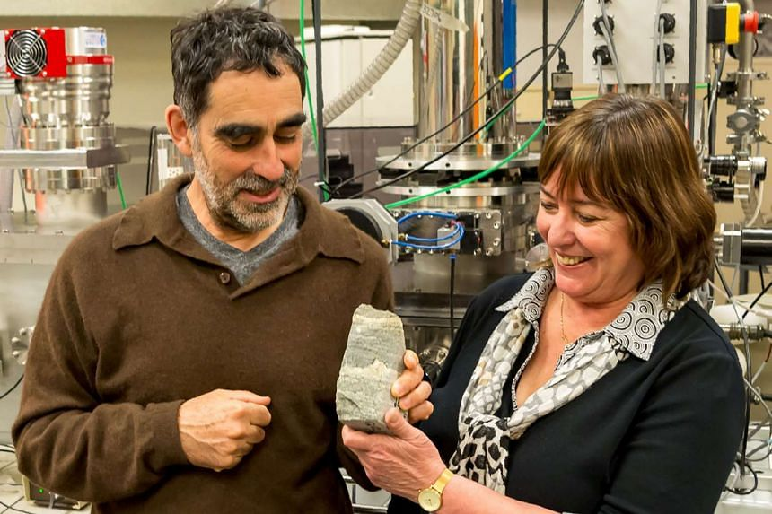 Research professor Allen Nutman (left) and associate professor Vickie Bennett displaying rock specimen containing 3.7-billion-year-old stromatolites from the Isua SupercrustalBelt in south-west Greenland.