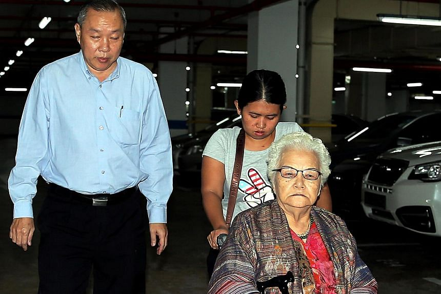 Sheng Shiong boss Lim Hock Chee arrives in court with his mother, Madam Ng Lye Poh.