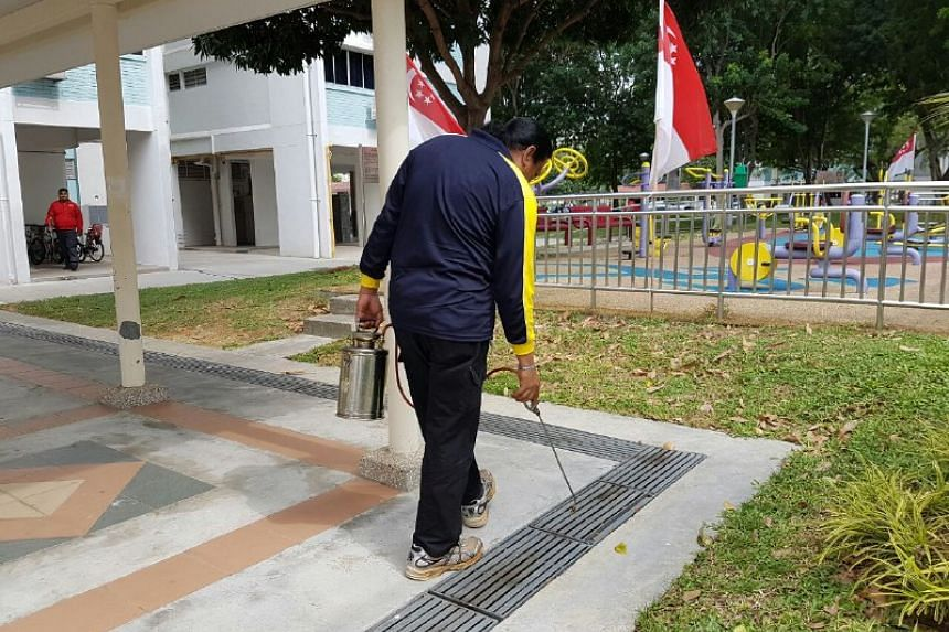 Chemicals being sprayed into drains at Bedok North Avenue 3 near Block 407 to prevent mosquito breeding on Sept 1, 2016.