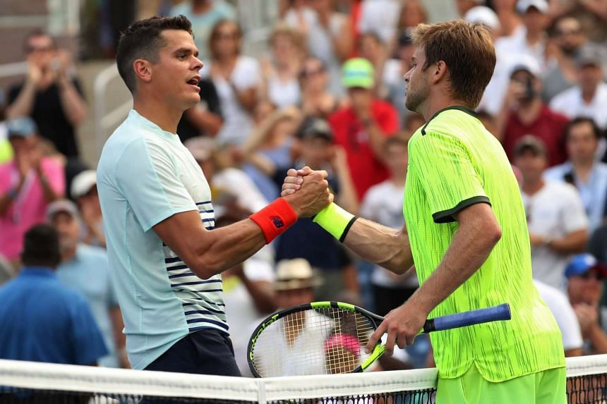 Ryan Harrison (right) shakes hands with Milos Raonic after their match on day three of the 2016 US Open tennis tournament at USTA Billie Jean King National Tennis Center on Aug 31, 2016.