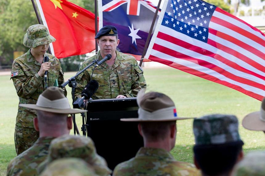 Australian Army officer Lieutenant Colonel Warwick Young addressing Australian, US and Chinese army personnel during the opening ceremony for Exercise Kowari, a trilateral exercise, on Aug 26.