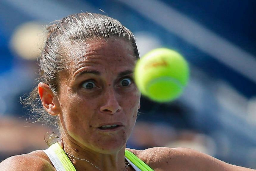 Roberta Vinci of Italy hits a return against Christina McHale of the US.