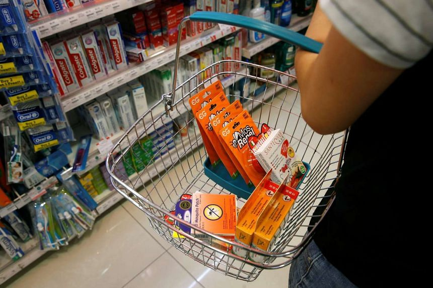A customer shops for remaining stocks of insect repellent products on Sept 2, 2016.