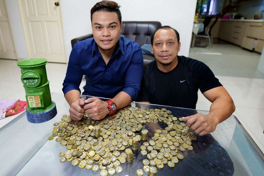 Mr Muhammad Helmy Kamid (left) started saving $1 coins two years ago. He was inspired by his uncle, Mr Anuar Ahmad.