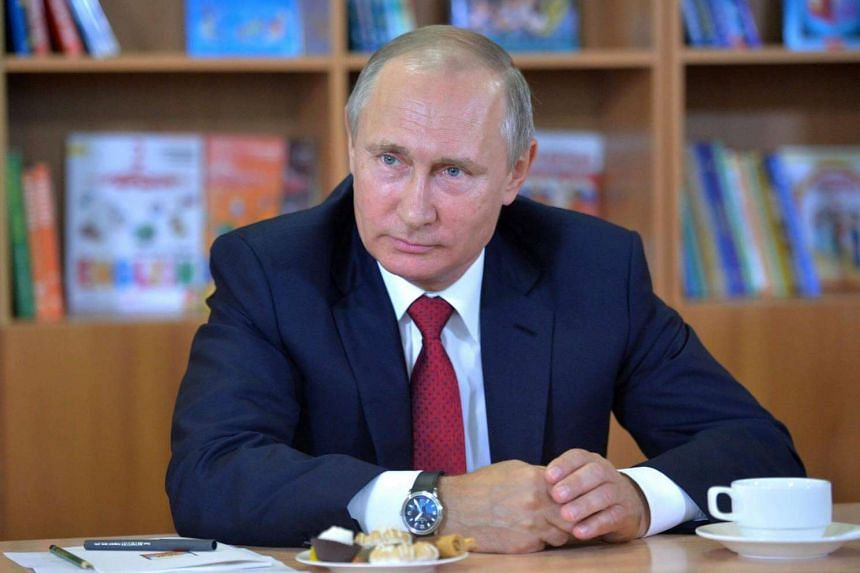 President Vladimir Putin talks to the pupils of Gymnasium No. 2 in Vladivostok, Russia on Sept 1. He struck a conciliatory tone before opening talks with Japan.