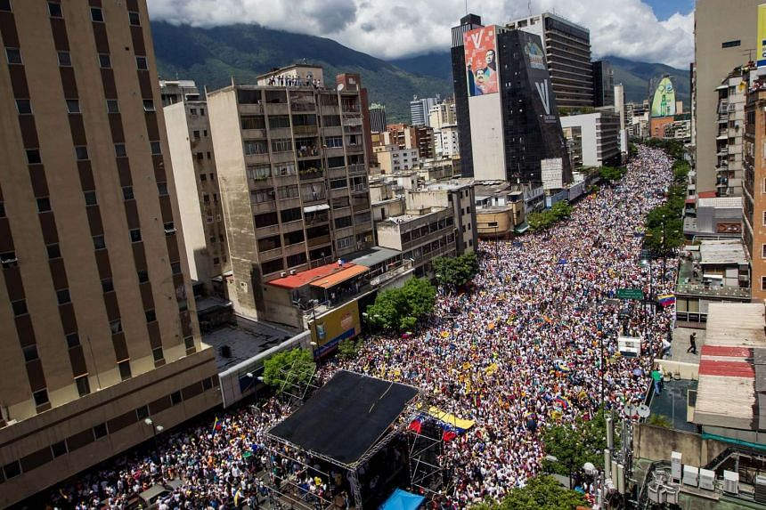 People take part in a protest in Caracas on Sept 1, 2016, demanding a referendum on removing the President from power.