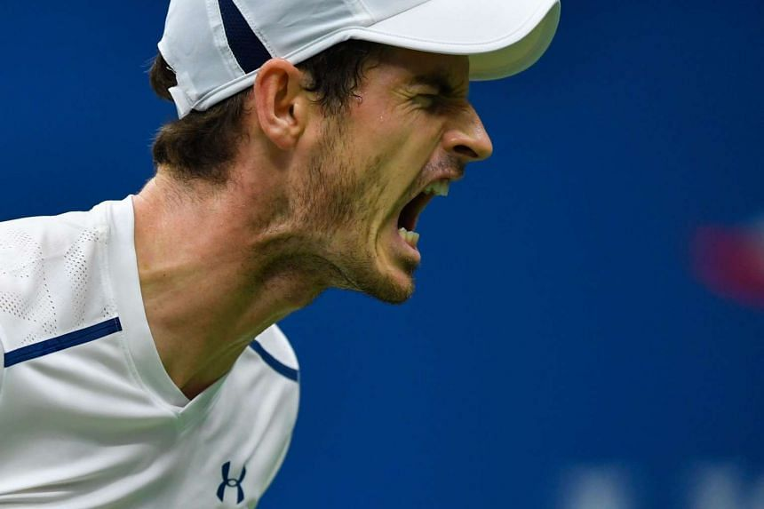 Andy Murray of Great Britain reacts after losing a point against Marcel Granollers of Spain.