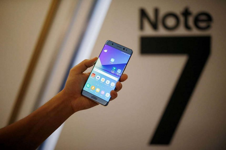 A model posing with a Galaxy Note 7 smartphone during its launching ceremony in Seoul, on Aug 11, 2016.