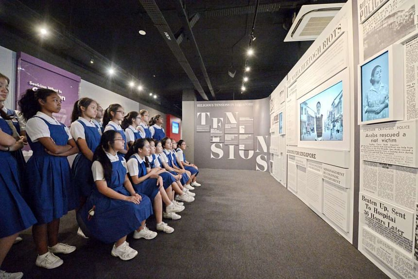 CHIJ Saint Nicholas Girls School students watching a video about the Maria Hertogh riots at the Harmony in Diversity Gallery on Sept 2, 2016.